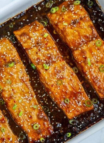 Baked teriyaki salmon in a baking dish.