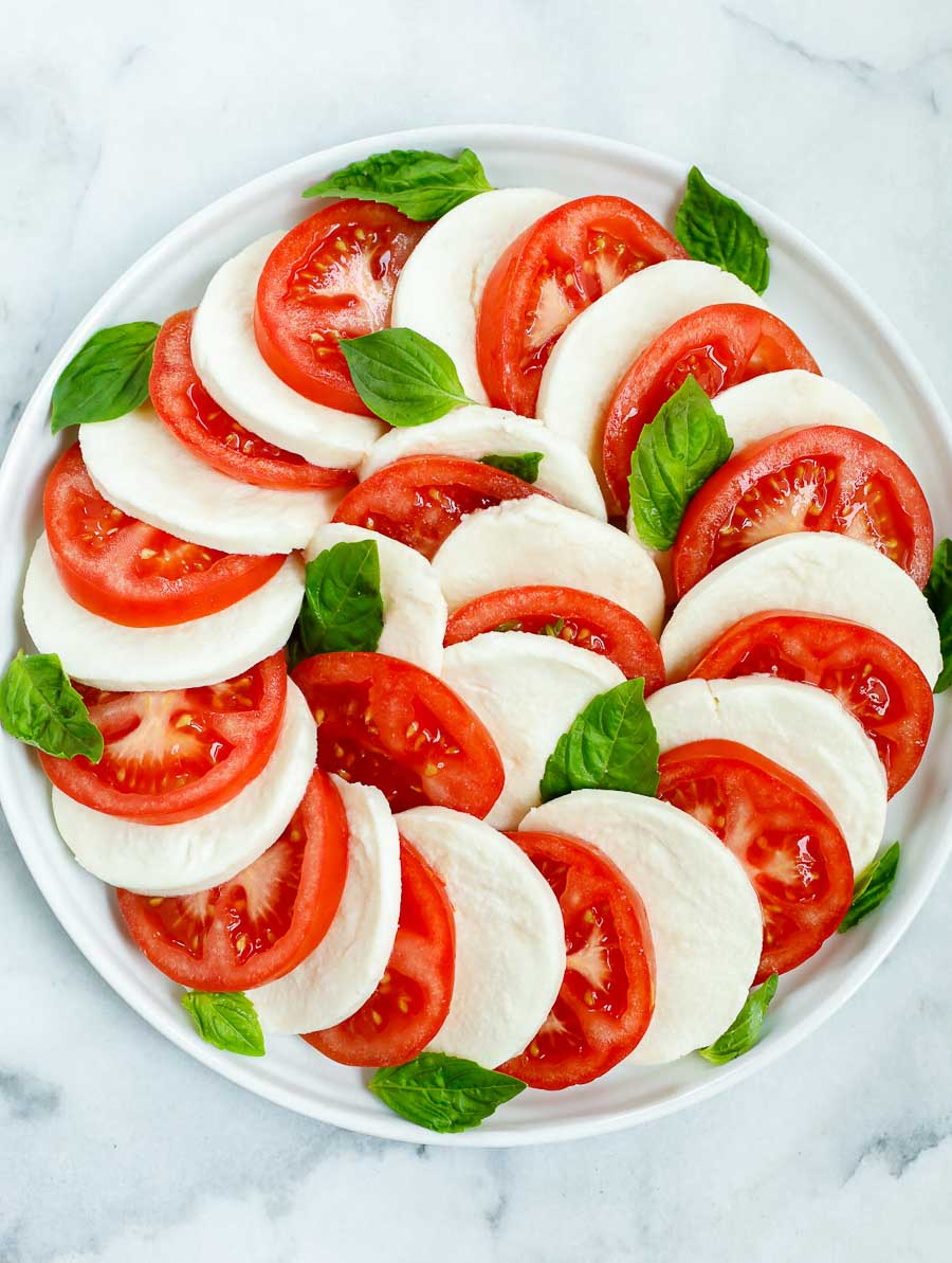 top down shot of the caprese salad after being assembled but before adding the dressing