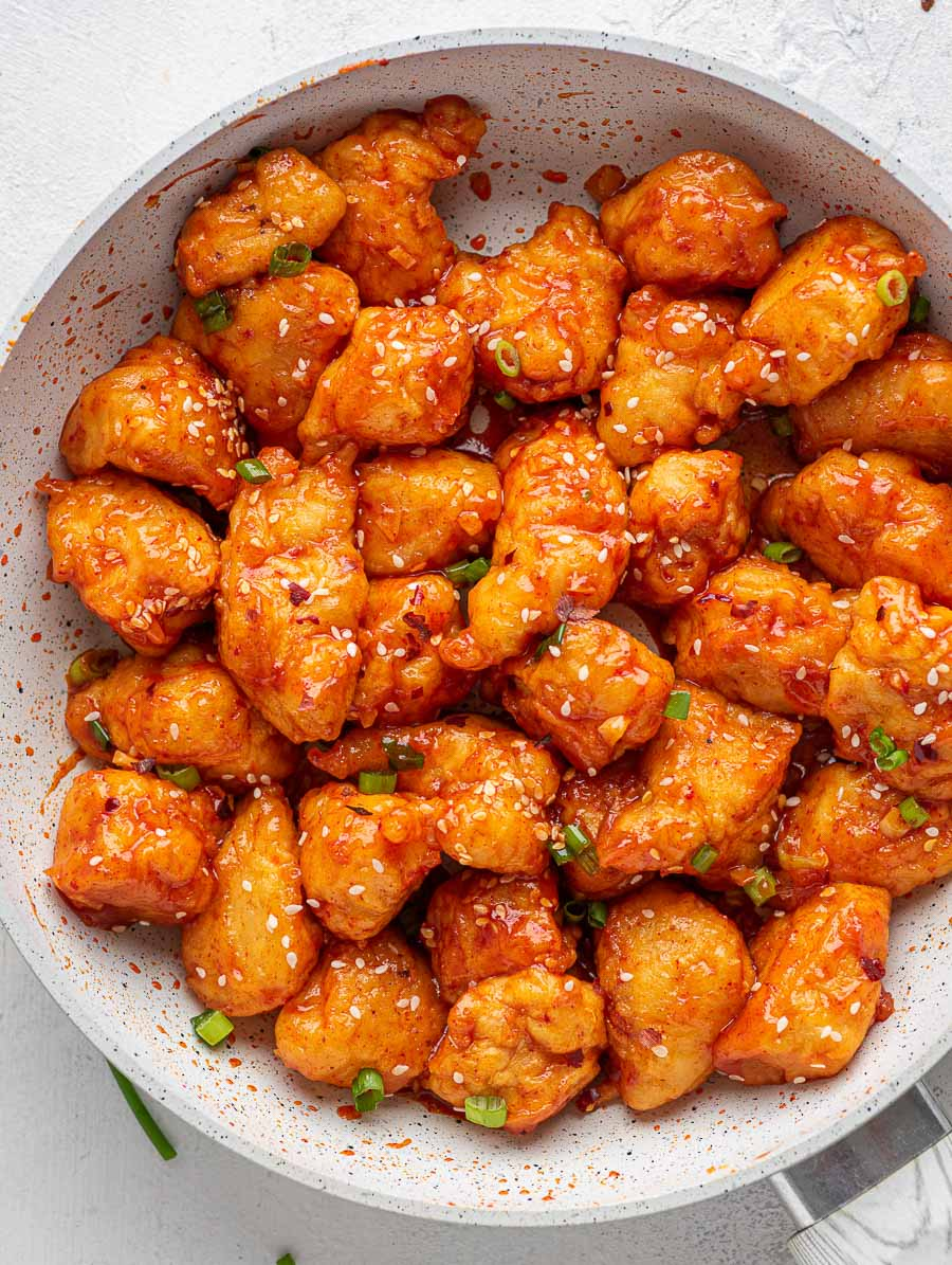 top down shot of sweet and spicy asian chicken in a skillet