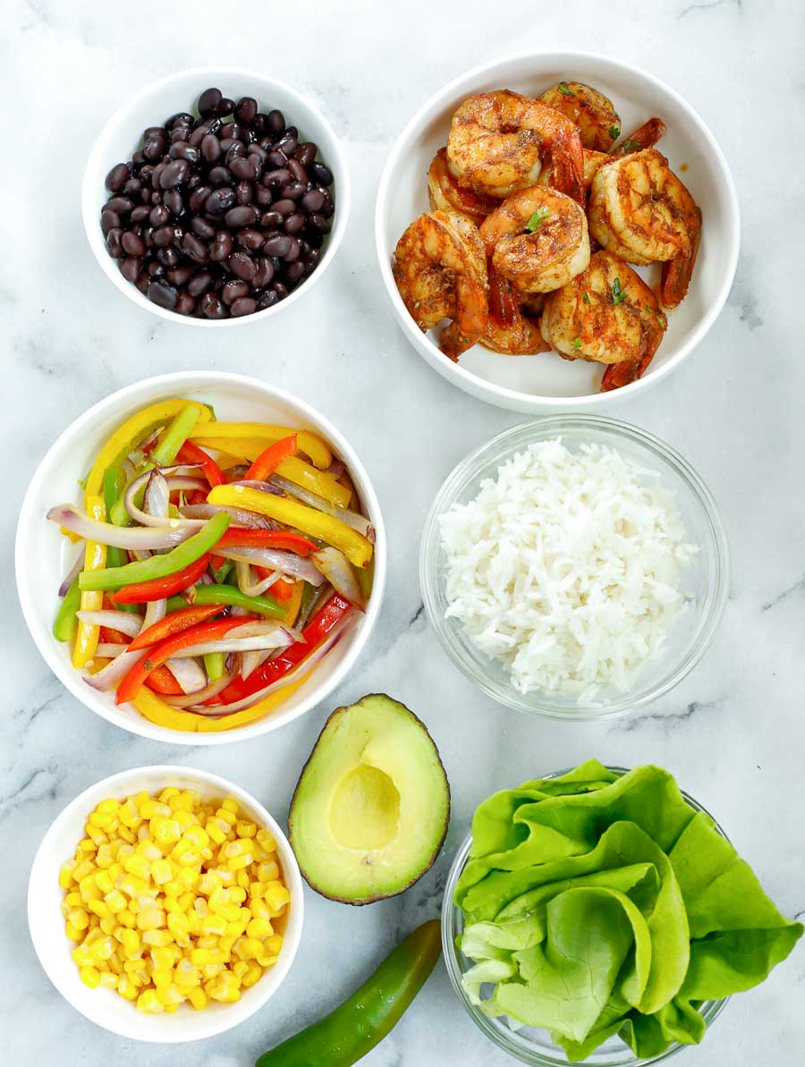 ingredients of chipotle shrimp bowl laid out