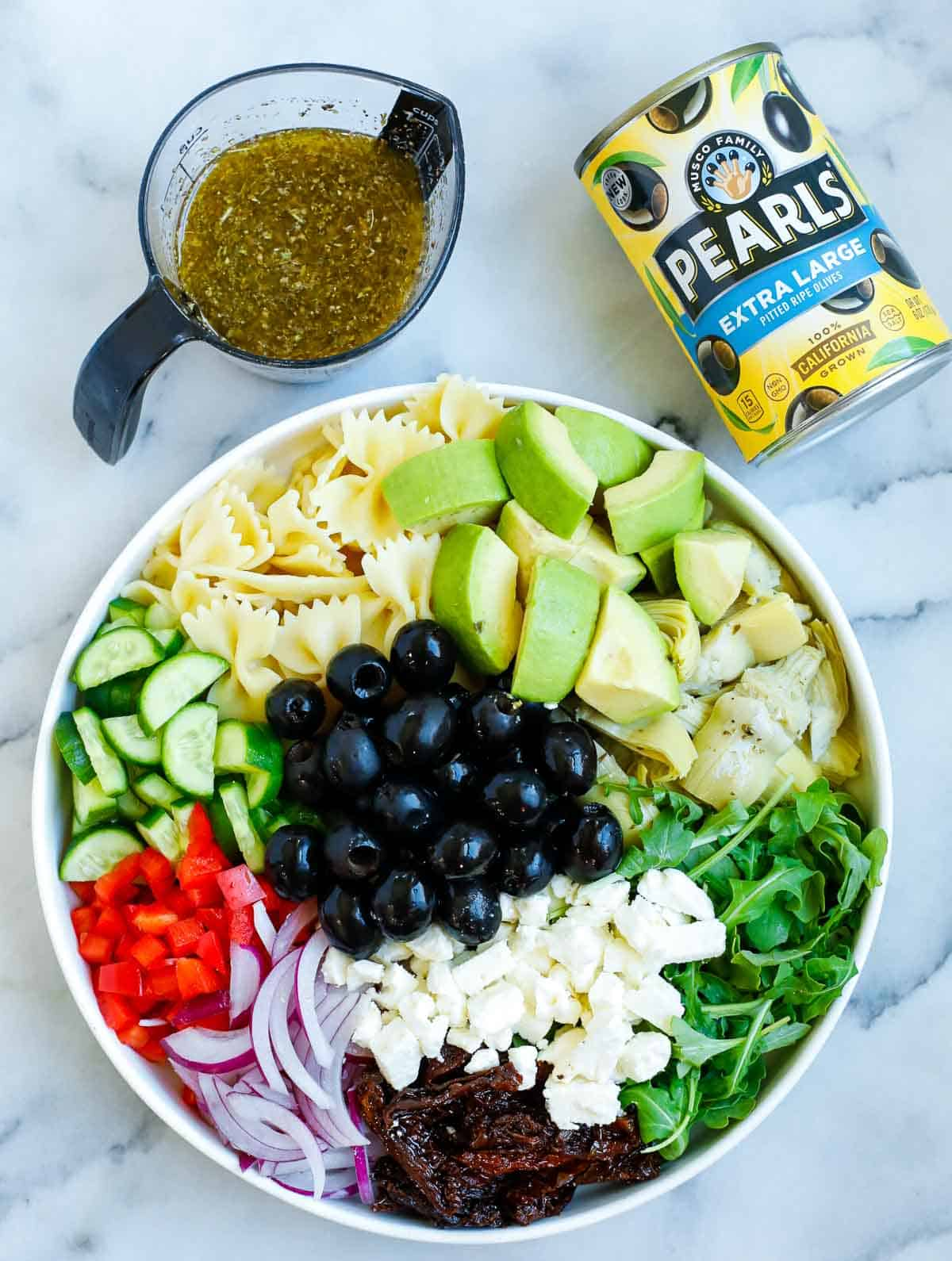 Ingredients for the pasta salad in a bowl before adding the dressing.