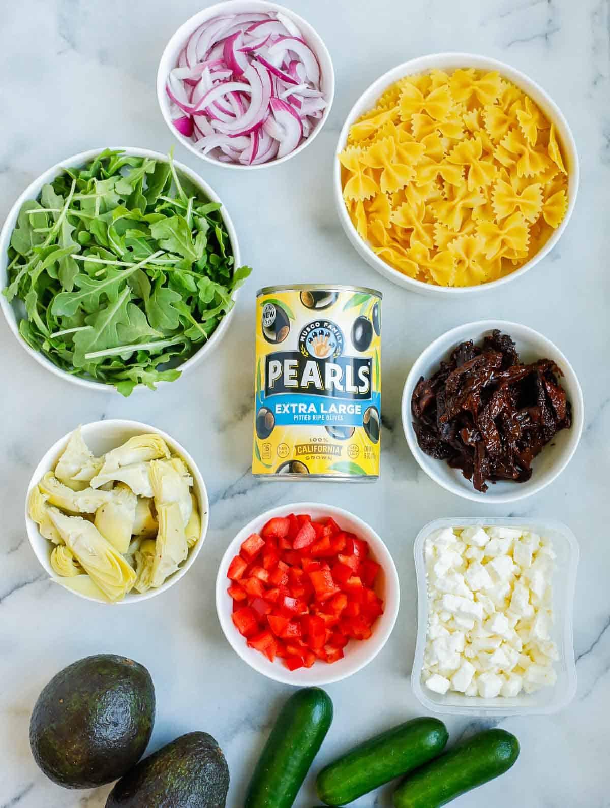 Ingredients needed to make Lemon Herb Mediterranean Salad.