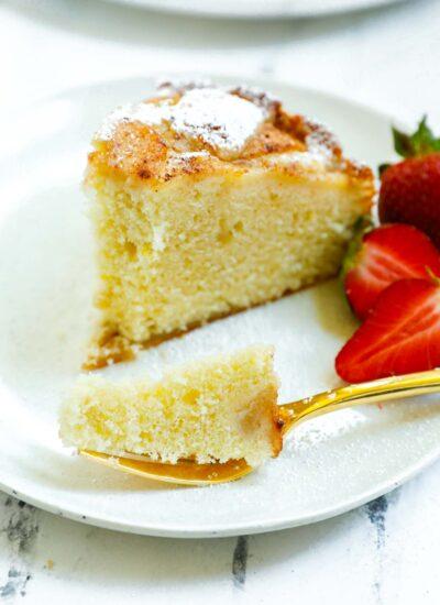 a bite of cake on a golden fork.