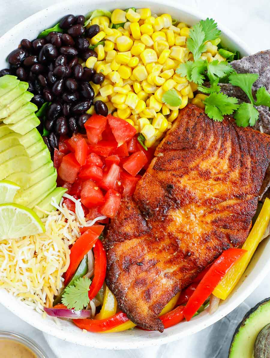 ingredients of spicy salmon salad placed in a bowl