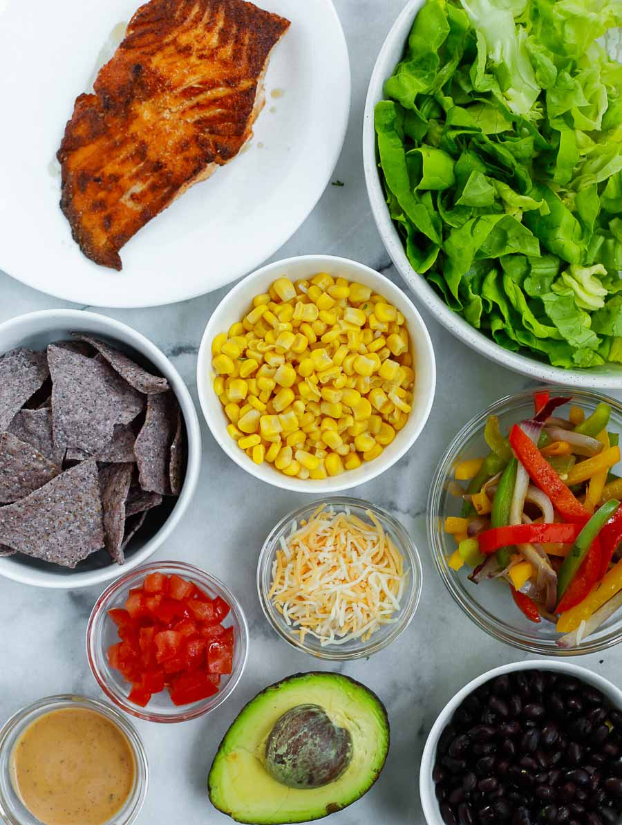 ingredients of the salmon burrito bowl laid out