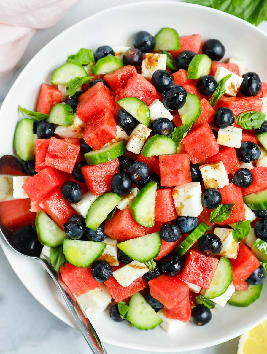 top down shot of the watermelon feta salad in a white bowl