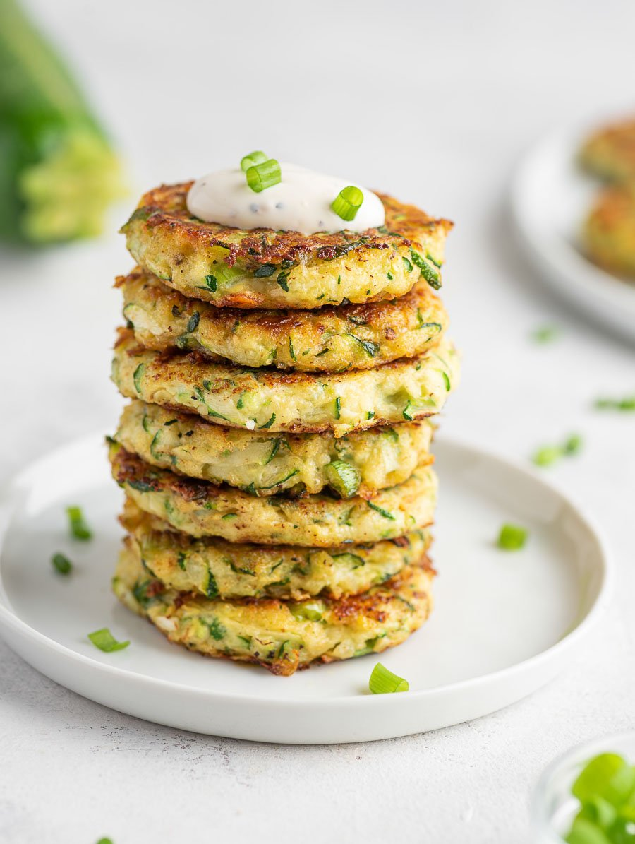 several zucchini fritters stacked on top of each other