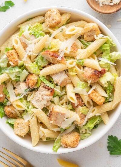 chicken ceasar pasta salad in a white bowl
