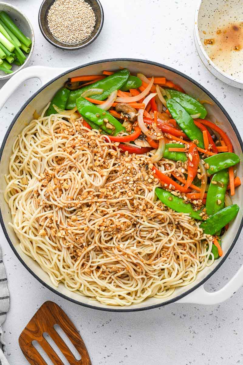 sauce poured over the lo mein noodles in a skillet