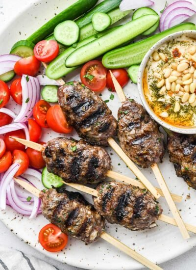 top down close up shot of the beef kofta on a plate with sides