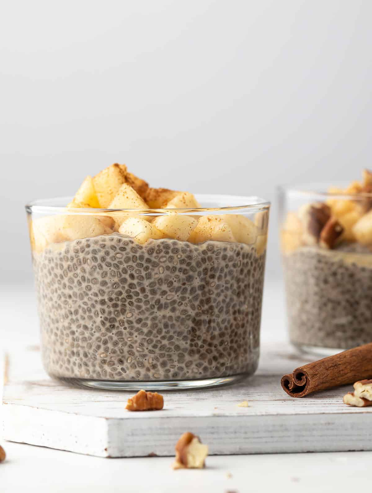 Overnight Chia Pudding topped with apples and sprinkled with cinnamon powder.