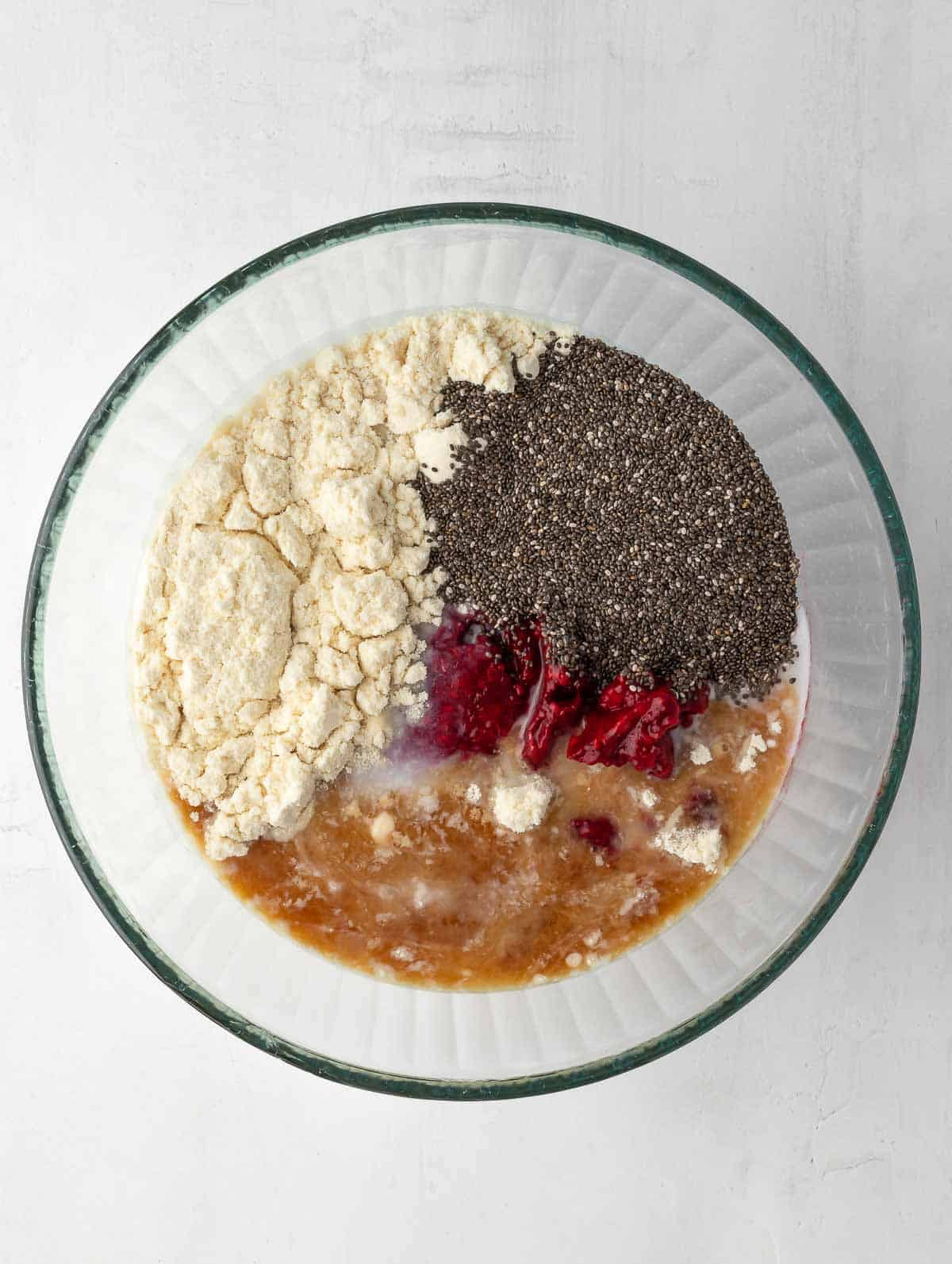 raspberry protein chia pudding ingredients placed in a bowl