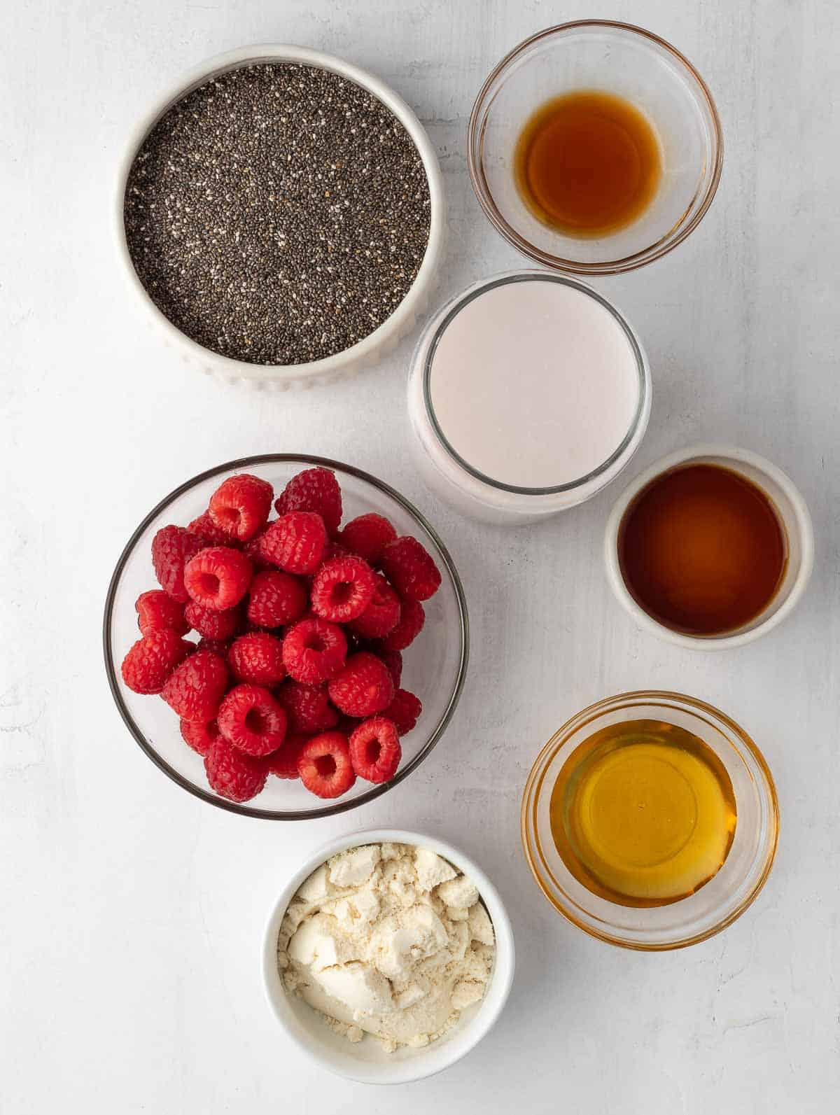 ingredients of Raspberry Protein Chia Seed Pudding laid out