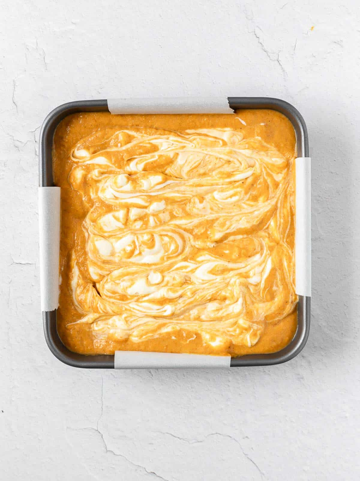 Cheesecake Swirled Pumpkin in a pan before baking