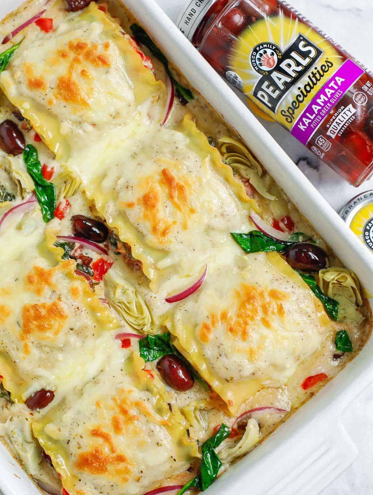 top down shot of the Greek White Alfredo Lasagna in a baking dish