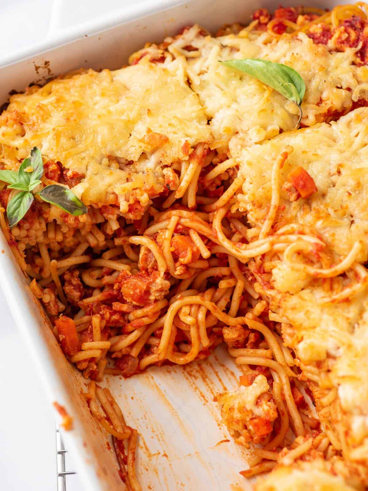 Easy Spaghetti Bake showing in the center in a dish