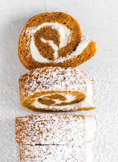pieces of pumpkin cake roll cut out and dusted with powdered sugar